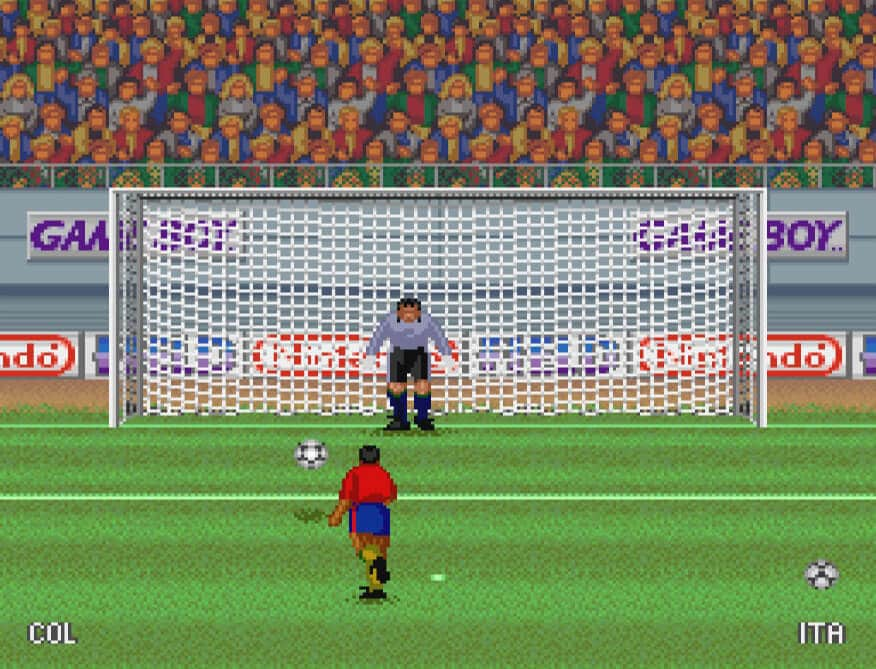 Player taking a penalty with the ball heading to the bottom left
